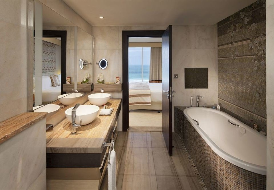 bathroom property sink Suite home toilet cottage tub Bath bathtub tile tiled tan