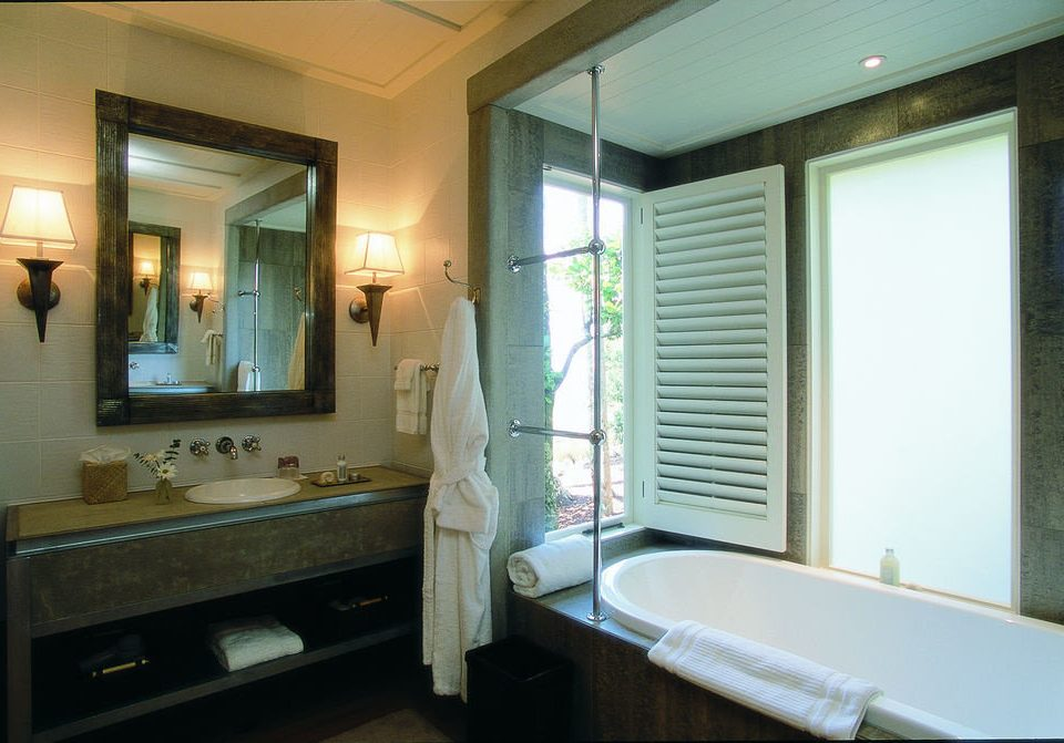 bathroom mirror property sink home condominium Suite cottage mansion tub Bath bathtub