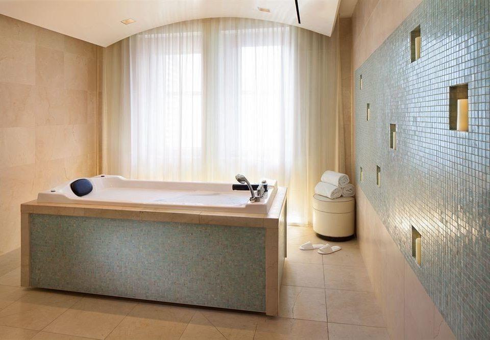 property bathroom bathtub swimming pool Suite flooring sink plumbing fixture toilet tub tile tiled Bath