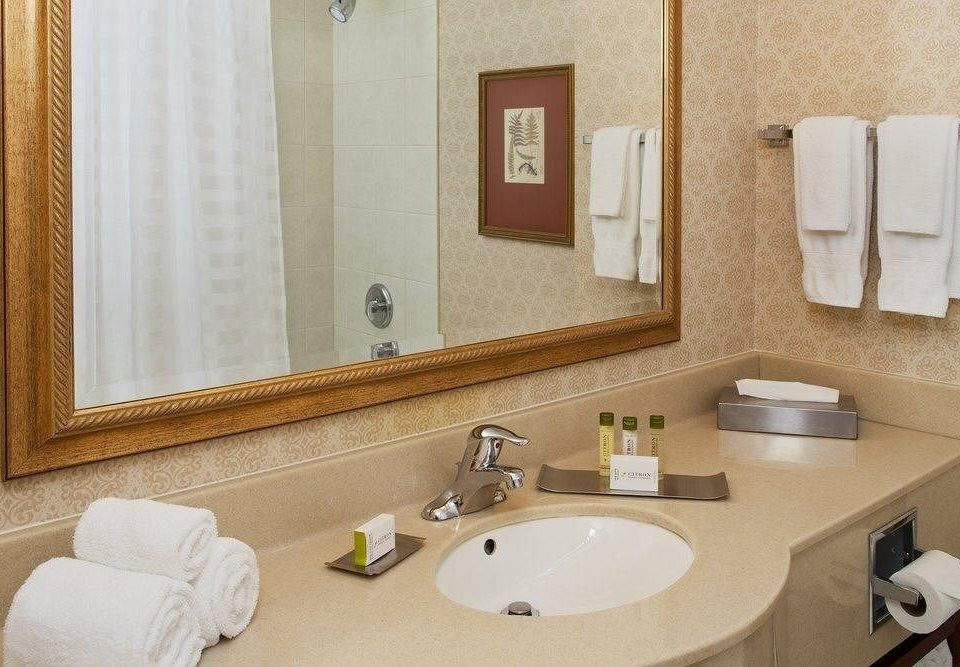 bathroom sink mirror towel property Suite home flooring plumbing fixture bathtub toilet cottage rack clean Bath