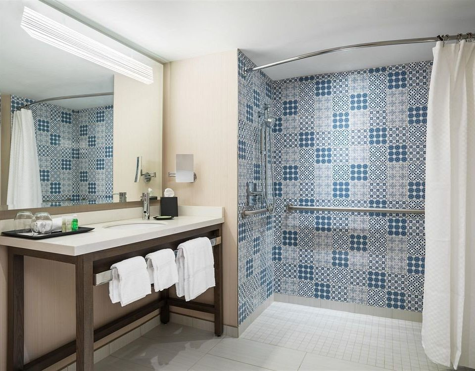 bathroom property curtain sink shower plumbing fixture home flooring bathtub Suite tub Bath tile tiled