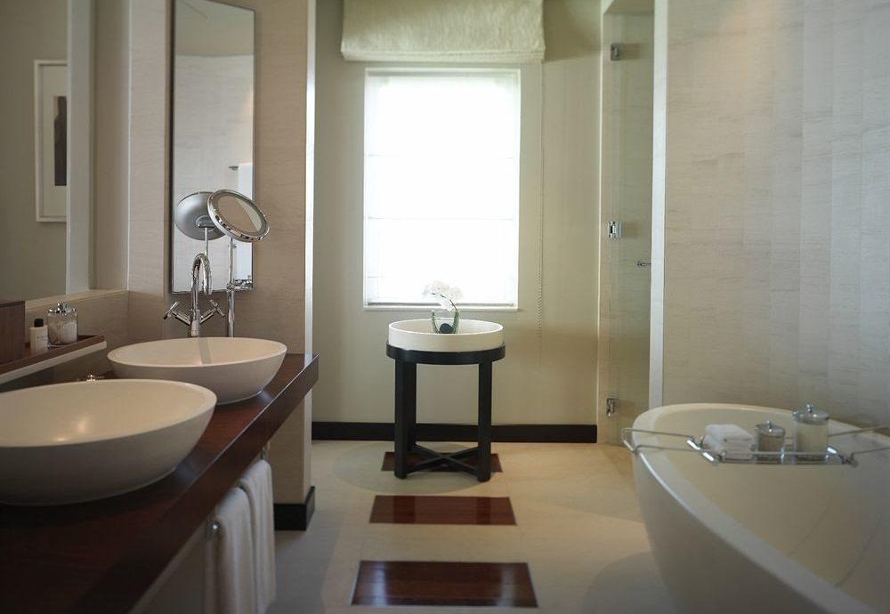 bathroom sink property home plumbing fixture Suite bathtub toilet tub Bath