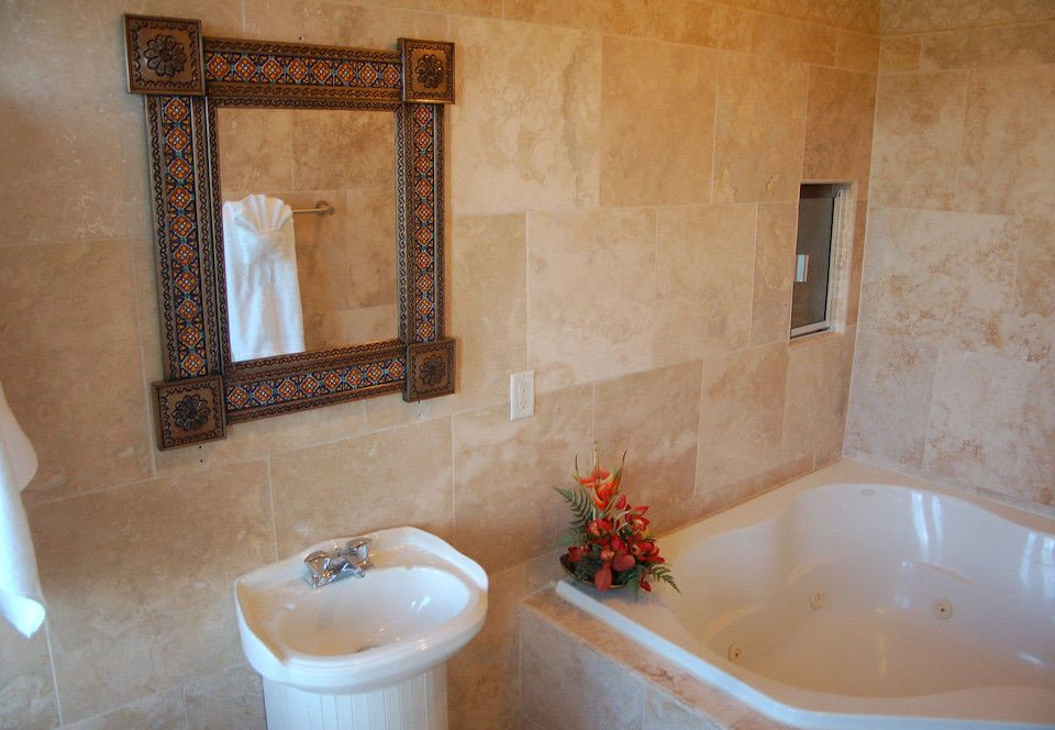 bathroom house property tub sink home cottage bathtub Bath flooring Suite plumbing fixture tiled