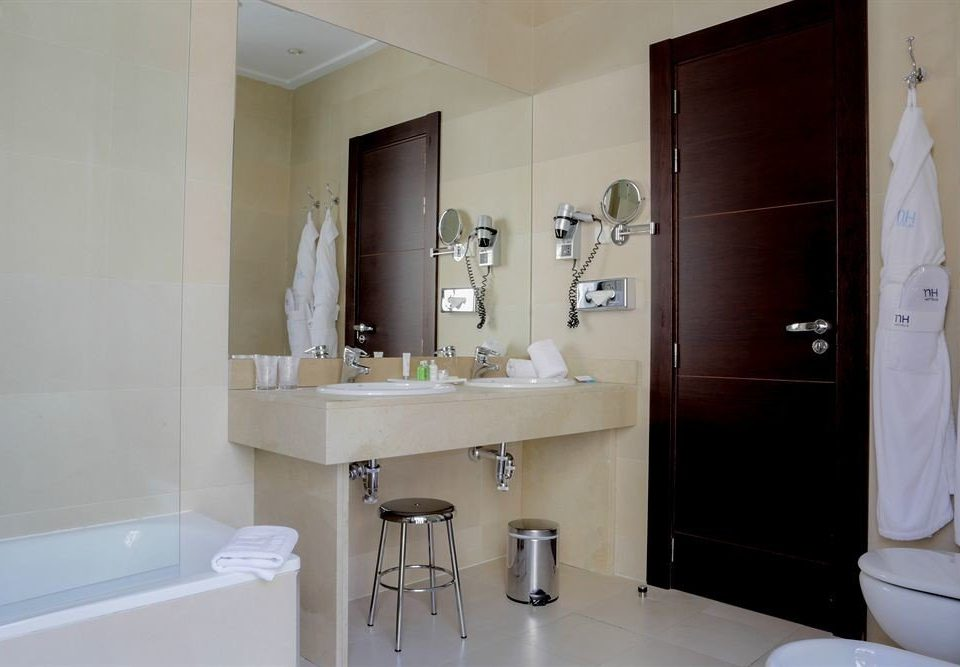 bathroom property sink mirror home Suite cottage toilet tub bathtub Bath