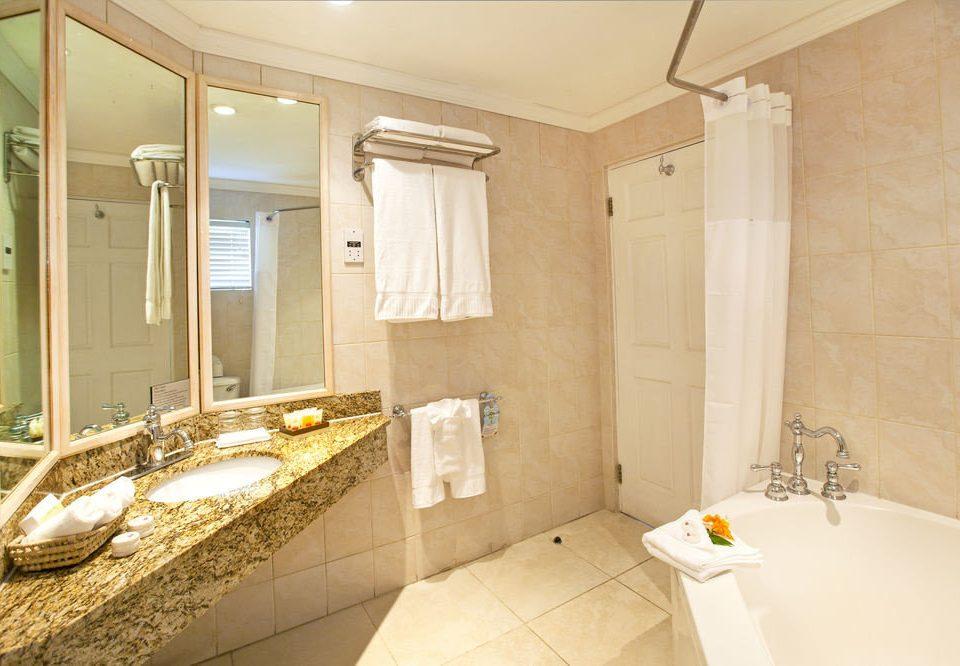 bathroom property sink toilet home Suite counter flooring Bath tub bathtub tiled