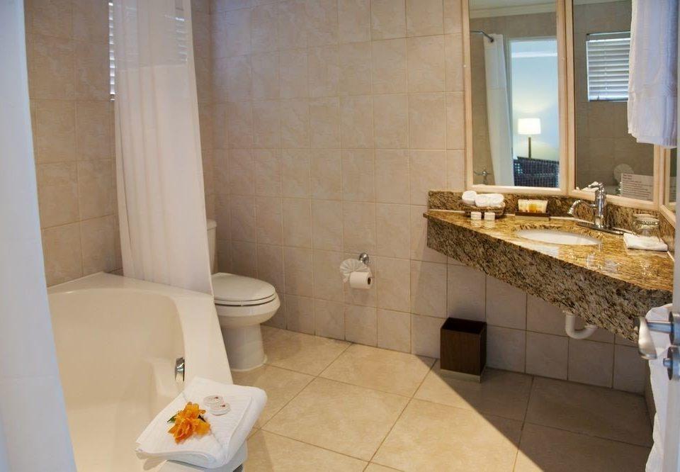 bathroom property sink house home toilet cottage Suite tile tub tiled bathtub Bath tan