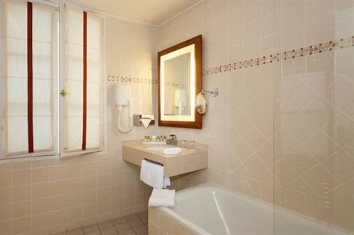 bathroom property sink flooring toilet plumbing fixture bathtub Suite tile tub tiled Bath