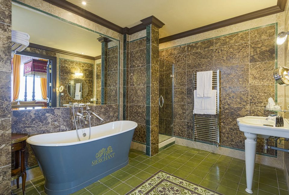 bathroom property swimming pool Suite home flooring bathtub plumbing fixture mansion tiled tile tub stone Bath