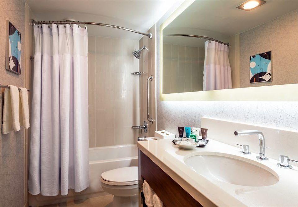 bathroom sink property shower mirror curtain toilet towel white Suite tub light clean rack bathtub Bath tile