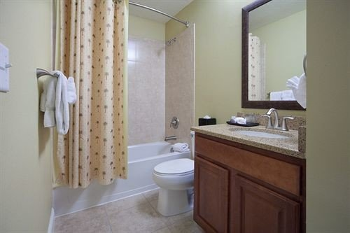 bathroom property mirror sink toilet shower white cottage Suite tile rack tub Bath bathtub