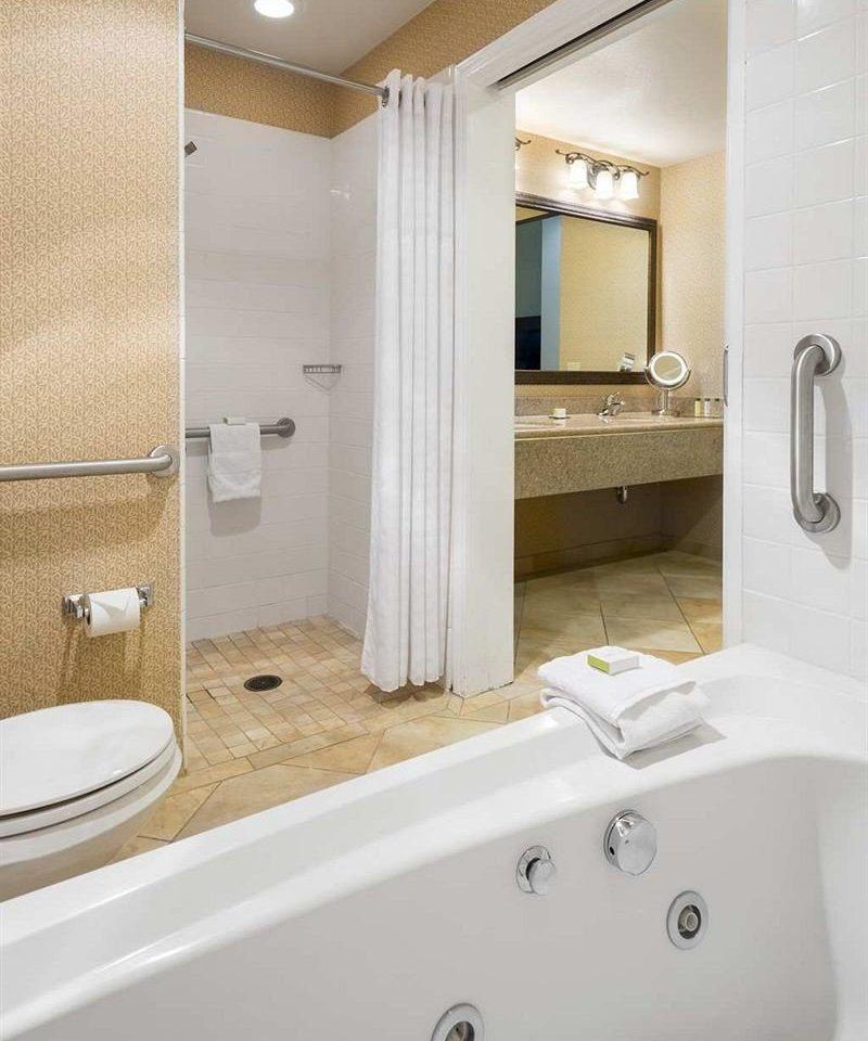 bathroom vessel sink property bidet bathtub plumbing fixture Suite toilet swimming pool water basin Bath tub tan