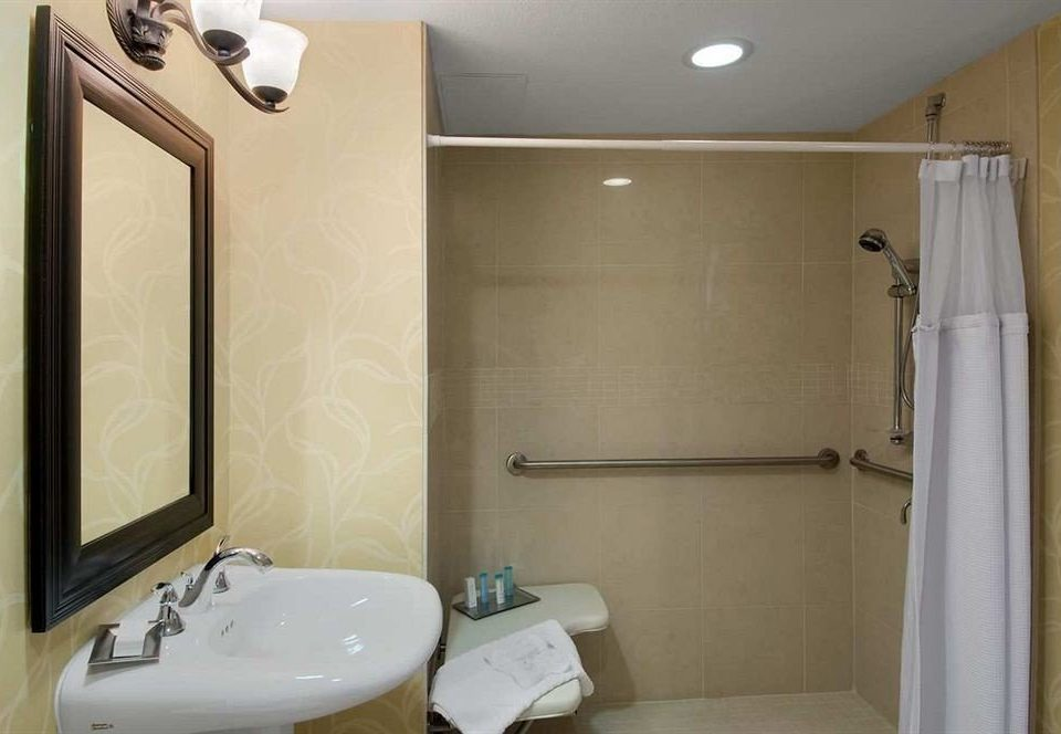 bathroom sink mirror property toilet white shower plumbing fixture tub public toilet Suite bathtub Bath tile tiled