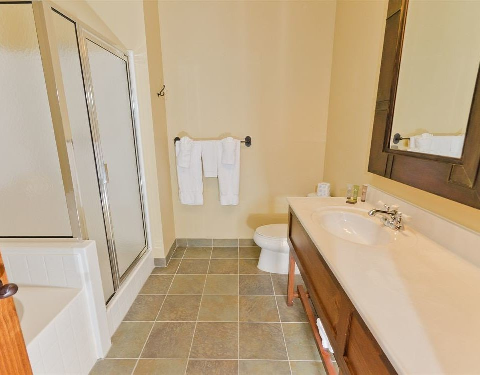 bathroom property sink hardwood Suite cottage home flooring tub bathtub tile Bath tiled