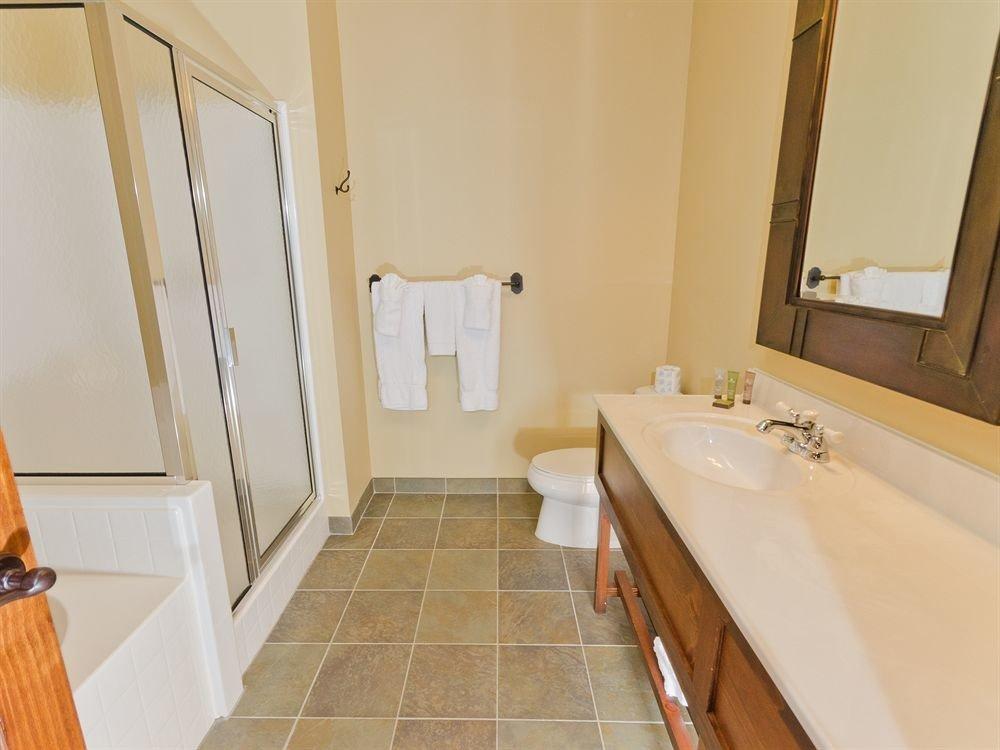 bathroom property sink hardwood Suite cottage home flooring tub bathtub tile Bath tiled