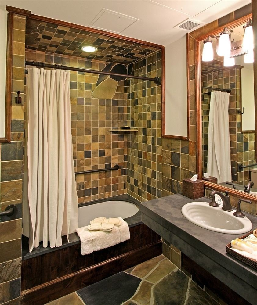 bathroom property sink flooring Suite plumbing fixture tub Bath bathtub tiled tile stone