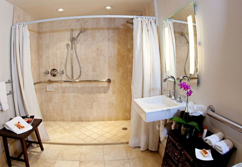 bathroom property cottage home Suite sink tub Bath bathtub tile tiled