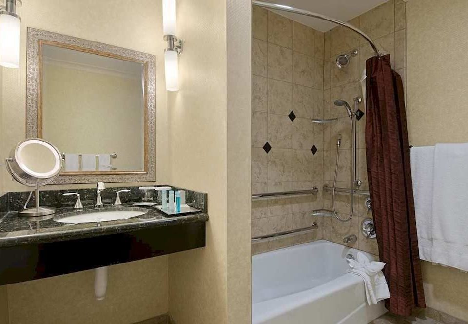 bathroom sink property mirror house home Suite cottage towel plumbing fixture tub Bath bathtub tile tiled