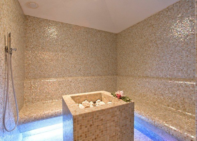 bathroom swimming pool property jacuzzi sink flooring counter Suite tub Bath bathtub tiled