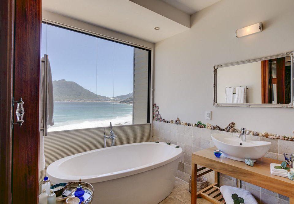 bathroom sink mirror property home Suite swimming pool cottage tub Bath bathtub