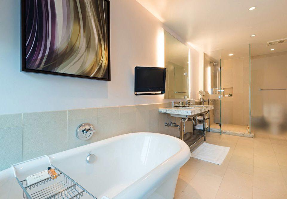 bathroom tub vessel property bathtub sink Bath Suite home tile tiled
