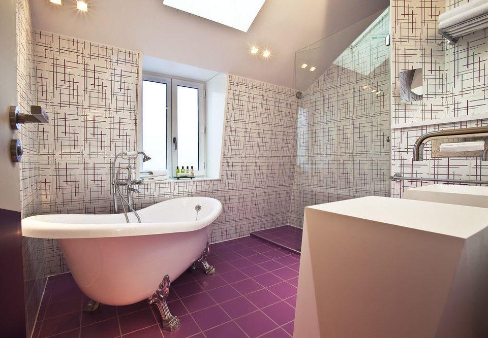 bathroom property bathtub Suite flooring plumbing fixture tiled tile Bath tub