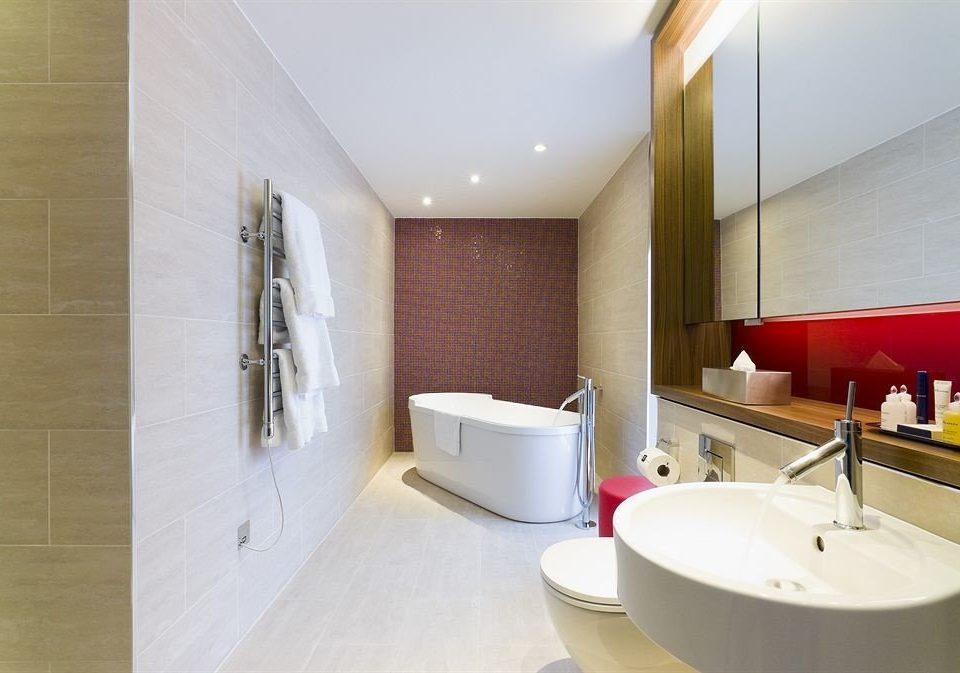 bathroom sink property mirror Suite counter tub Bath bathtub
