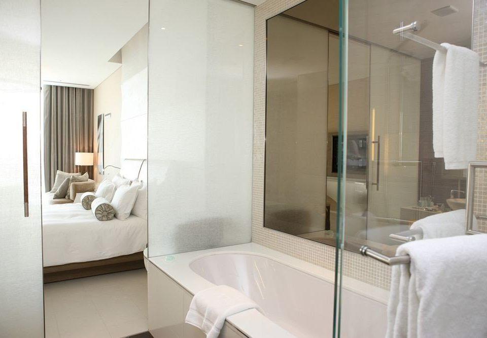 bathroom mirror property sink Suite towel shower plumbing fixture condominium bathtub bidet tub Bath