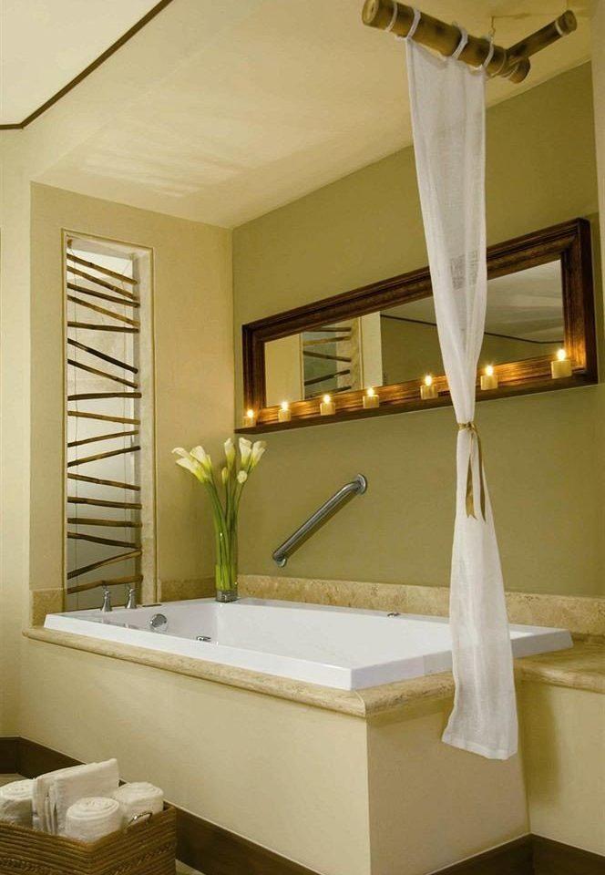 bathroom mirror property sink lighting home towel Suite bathtub Bath tub