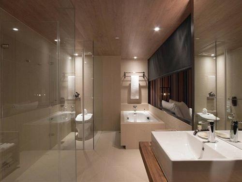 bathroom property sink toilet lighting flooring Suite tub bathtub tile Bath tiled