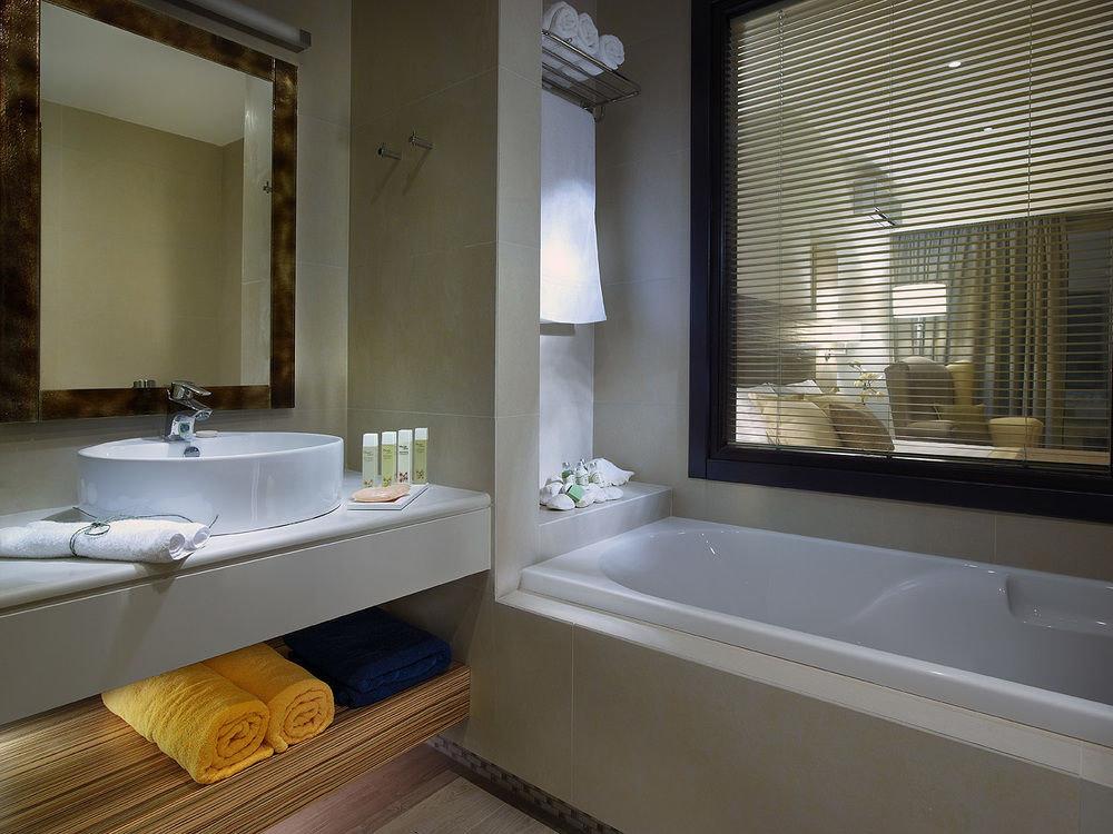 bathroom sink property home bathtub Suite plumbing fixture flooring tub Bath tan