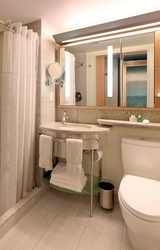 bathroom property sink toilet plumbing fixture home Suite flooring public toilet towel bathtub tub Bath