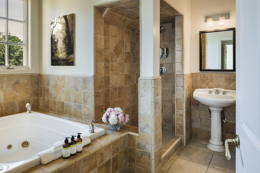bathroom sink property bathtub plumbing fixture flooring home Suite counter Bath