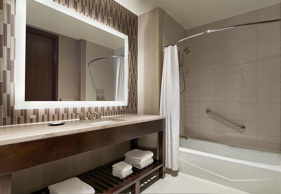 bathroom sink mirror property house home towel counter bathtub plumbing fixture cabinetry Suite tub Bath tile