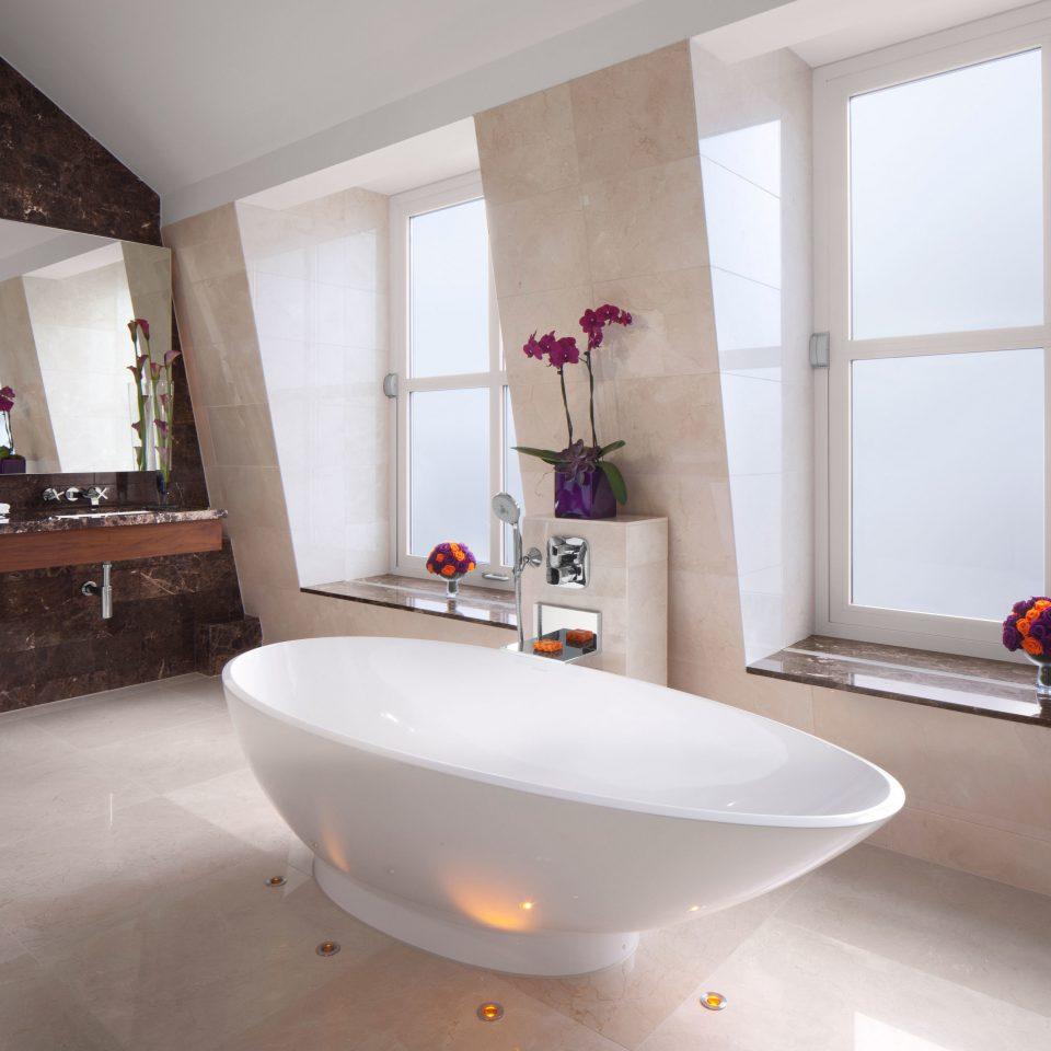 property bathroom bathtub sink plumbing fixture flooring Suite bidet tub Bath tiled