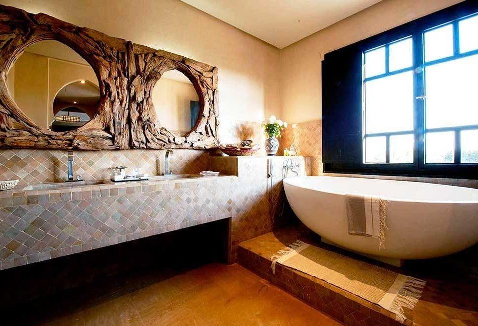 property bathroom home countertop bathtub Suite swimming pool tub stone Bath tiled