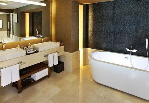 bathroom property Suite sink swimming pool tub bathtub flooring plumbing fixture jacuzzi Bath tan tiled