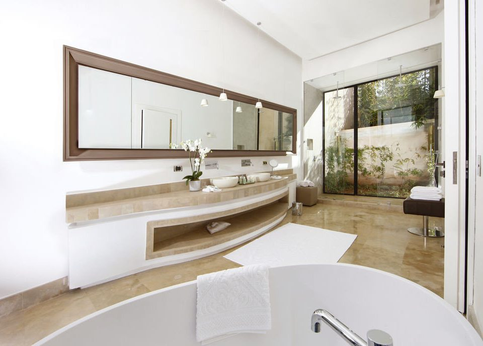 bathroom property sink home tub condominium Suite bathtub toilet living room Bath