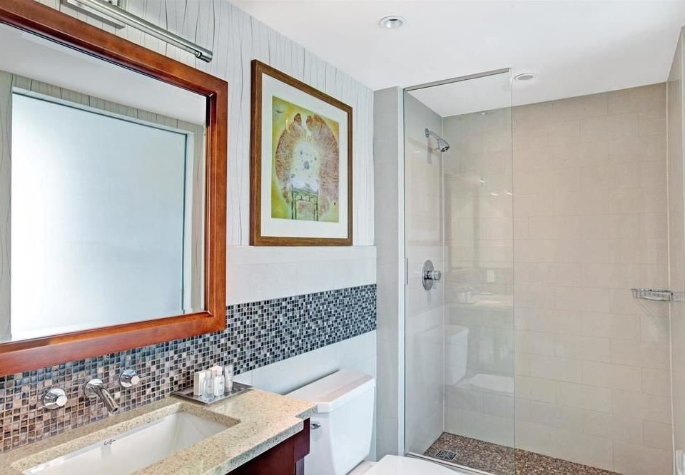 bathroom property sink mirror home Suite condominium tub tiled clean bathtub tile Bath