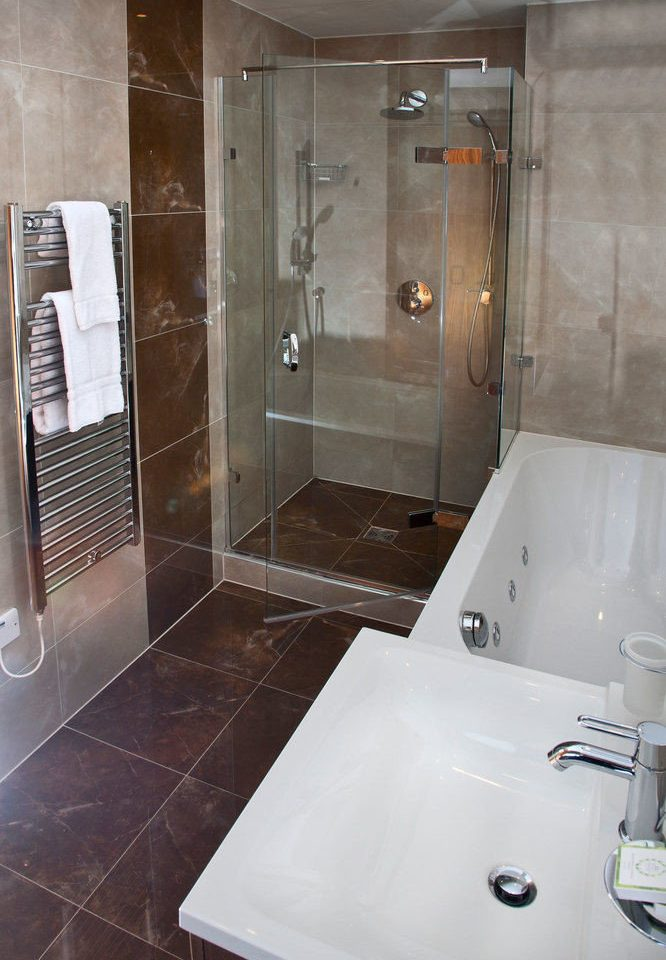 bathroom property vessel plumbing fixture shower swimming pool Suite tiled toilet public toilet tile tub bathtub Bath