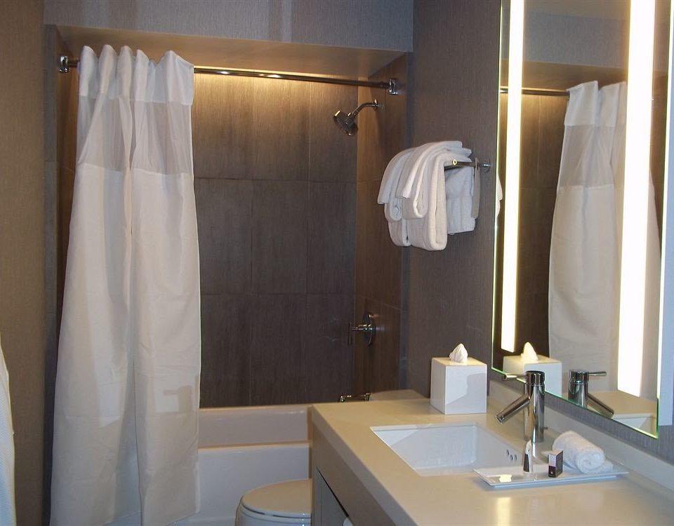 bathroom curtain towel shower sink property toilet white Suite plumbing fixture rack tub clean Bath bathtub