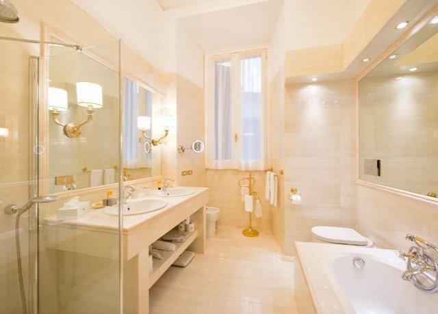 bathroom property tub Suite sink toilet bathtub flooring Bath tile