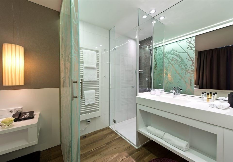 bathroom mirror property sink home Suite condominium tub bathtub Bath