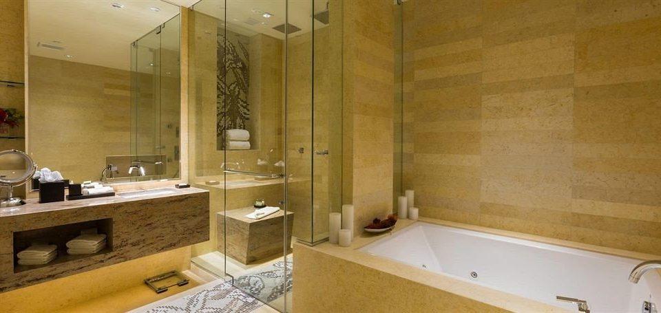 bathroom sink mirror property Suite flooring plumbing fixture tub Bath bathtub tan tile