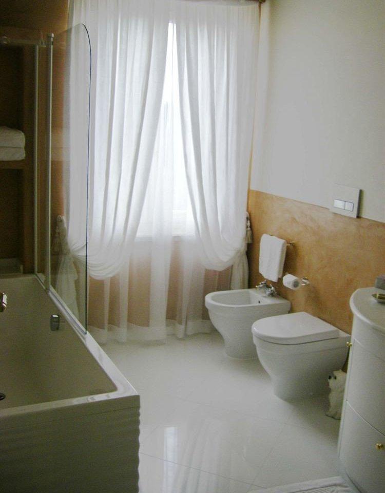 bathroom property curtain tub Suite sink plumbing fixture window treatment bathtub Bath