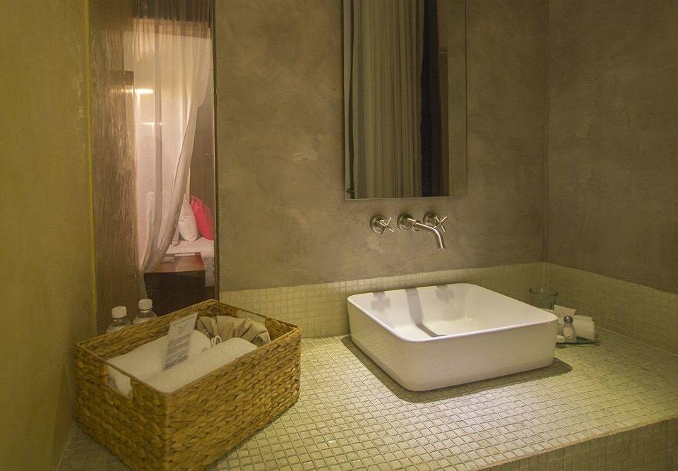bathroom property sink house plumbing fixture bathtub towel swimming pool Suite jacuzzi tan Bath tub