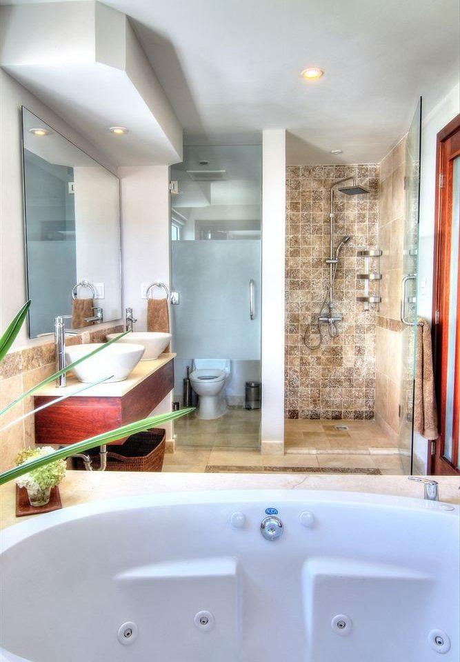 bathroom sink vessel property bathtub swimming pool tub home toilet flooring plumbing fixture Suite water basin Bath tile