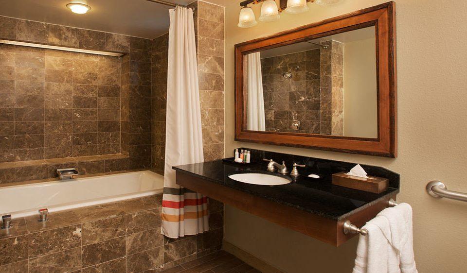 bathroom mirror property sink Suite home tub flooring Bath bathtub tile