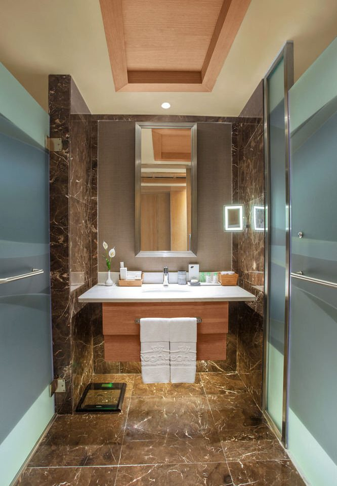 bathroom mirror property home sink flooring cabinetry countertop Suite tub Bath bathtub