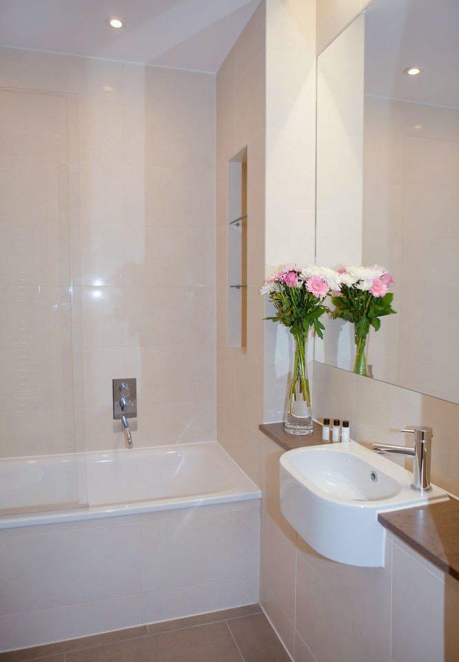 bathroom property flower pink toilet sink white plumbing fixture flooring Suite bathtub tub bidet Bath