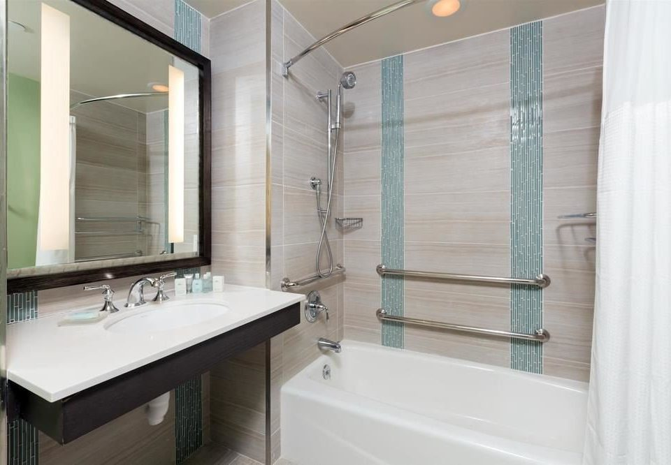 bathroom sink mirror shower property tub white bathtub Suite plumbing fixture Bath clean tile tan